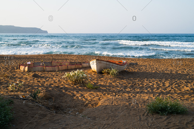 Boat beached in the sand on the coast of Chania, Crete, Greece