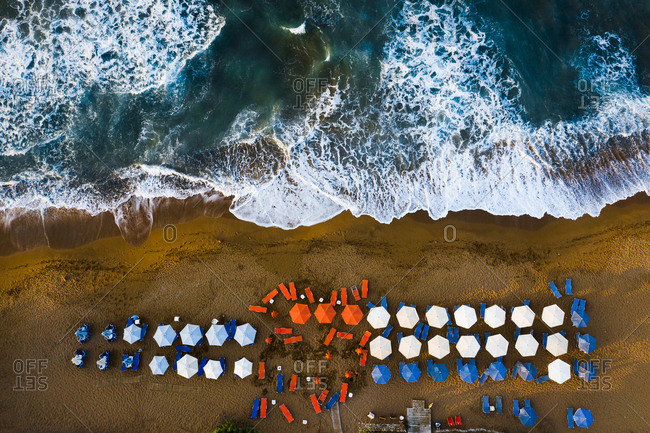 Chania, Crete, Greece - August 24, 2019: Aerial view of beach with umbrellas and lounge chairs