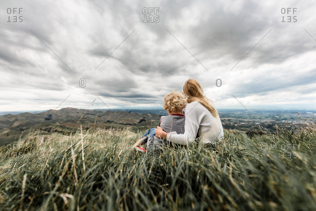 Rear view of two blonde children looking out at Te Mata Peak in New Zealand