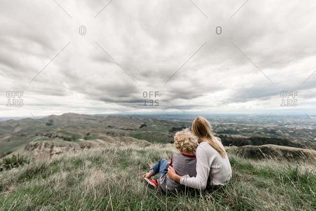 Back view of two blonde children looking out at Te Mata Peak in New Zealand