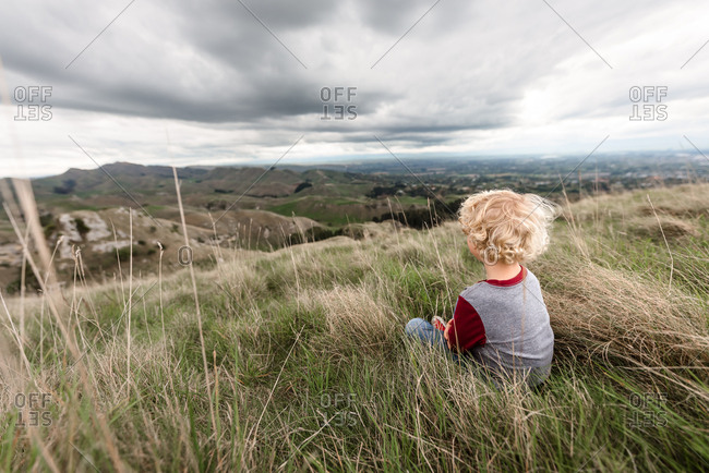 Little boy looking out at Te Mata Peak in New Zealand