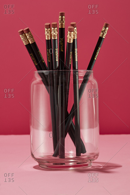 Pencils that say #hustle in a glass jar