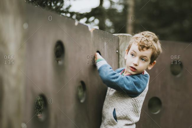 Portrait of boy climbing at playground