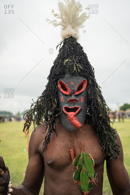 Man wearing a mask featuring a long tongue during the Mask Festival