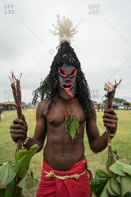 Man wearing a black and red mask during the Mask Festival 2019