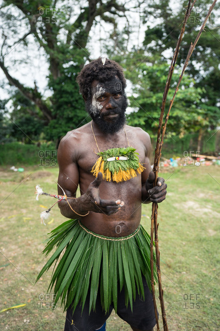 Kokopo, East New Britain, Papua New Guinea - July 11, 2019: Tribesman wearing clothes made with vegetation after the Mask Festival