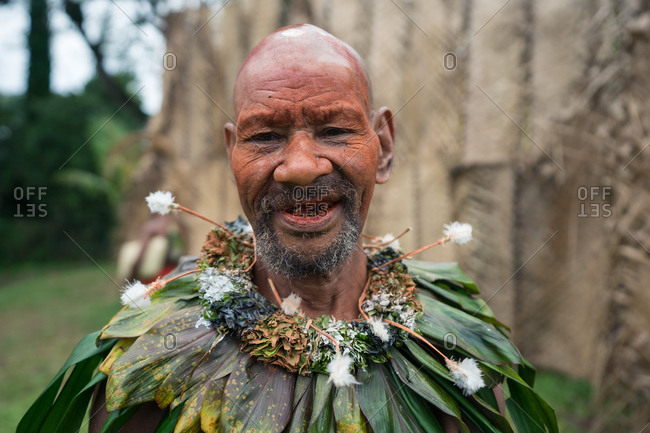 Kokopo, East New Britain, Papua New Guinea - July 11, 2019: Old man from a Papua clan after performing a traditional dance