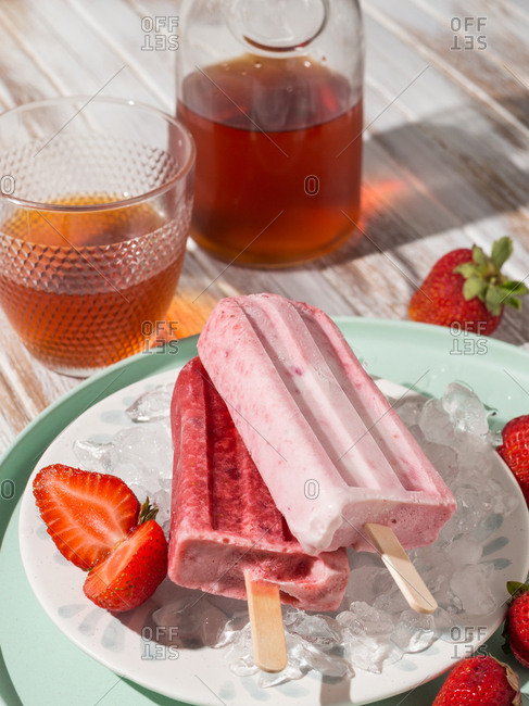 Refreshing strawberry popsicle on plate