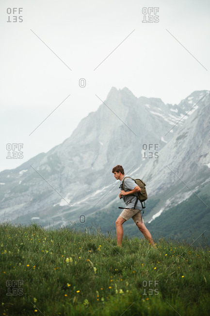 Unrecognizable man with backpack hiking in Pyrenees mountains
