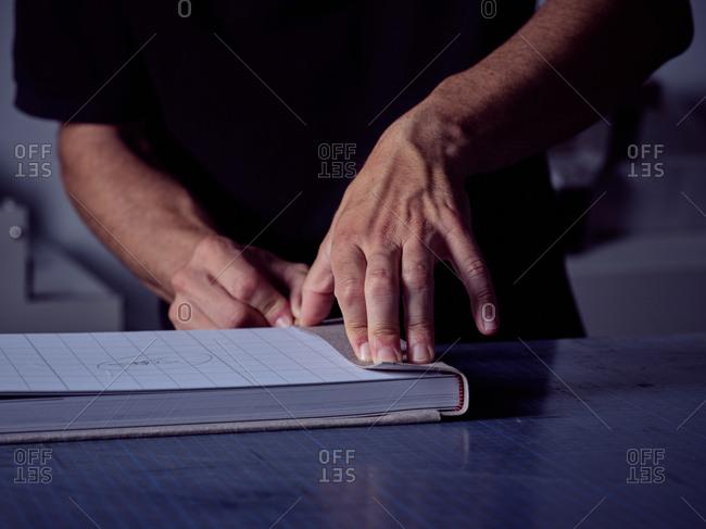 Craftsman making book in workshop