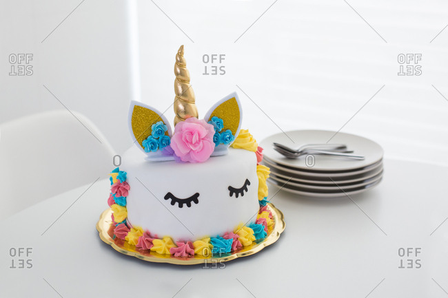 Cute unicorn cake with painted closed eyes