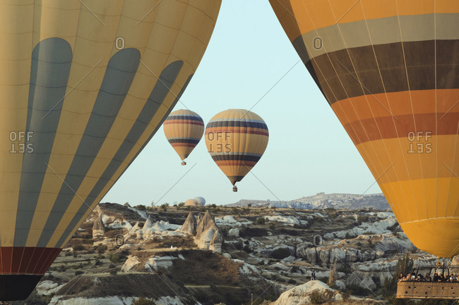 August 22, 2019: Cappadocia, Turkey - Jul 31, 2019: People in a hot air balloon at Cappadocia