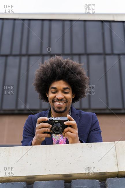 Happy stylish man looking at a camera