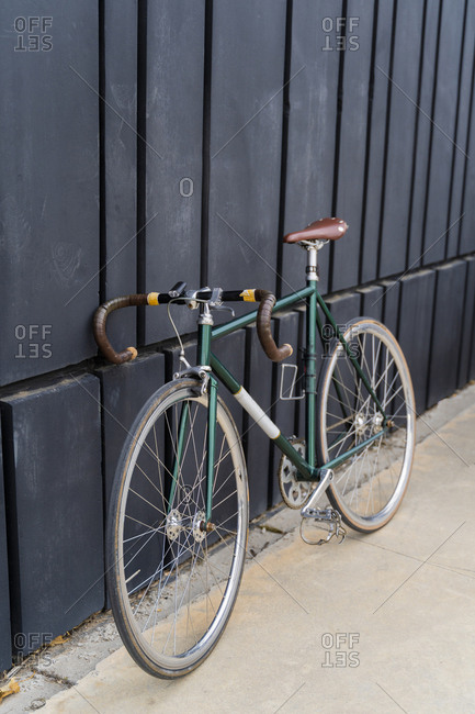 Racing bicycle leaning against a wall