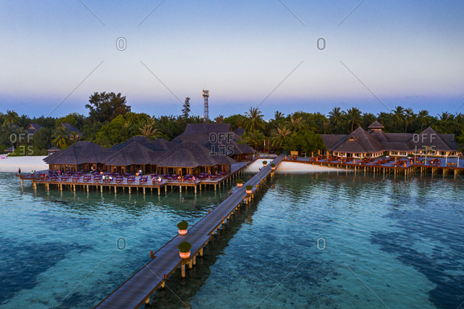 April 2, 2019: Maldives- Olhuveli island- Pier and resort on South Male Atoll lagoon at sunset