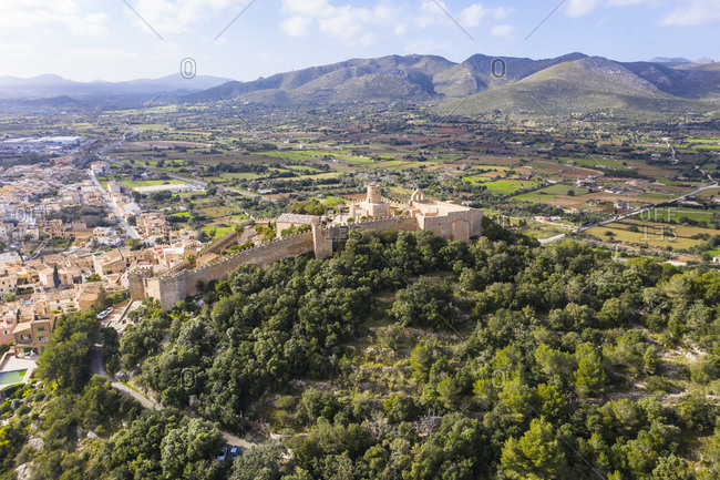 Aerial view of Castle Of Capdepera by trees against sky