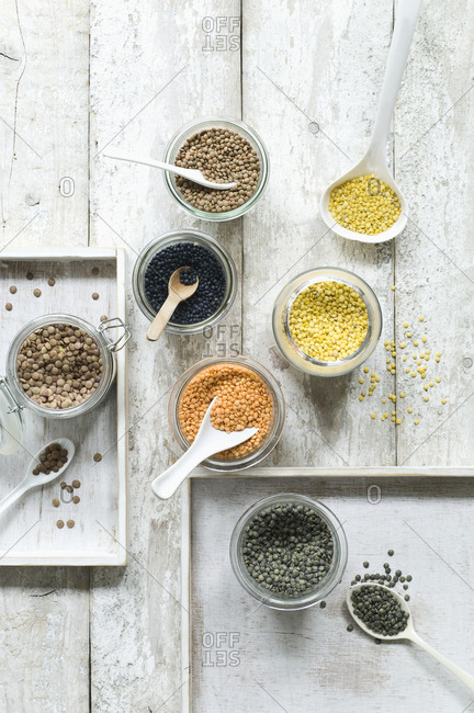Assorted lentils on wooden table seen from above