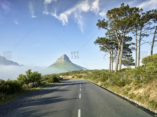 Empty asphalt road toward Lions Head mountain- Cape Town- South Africa