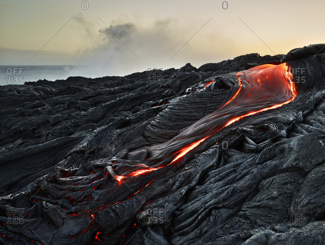 Lava flowing from Pu'u O'o' at Hawaii Volcanoes National Park against sky