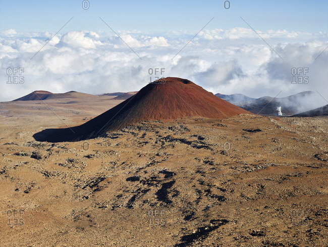 Idyllic view of Mauna Kea volcano against cloudy sky
