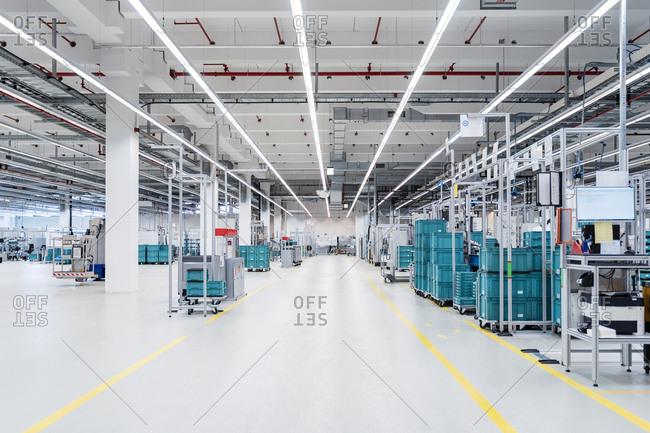 Illuminated warehouse of modern factory- Stuttgart- Germany