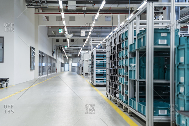Stacked containers inside modern factory warehouse- Stuttgart- Germany