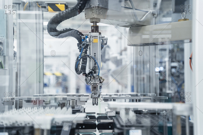 Arm of assembly robot functioning inside modern factory- Stuttgart- Germany