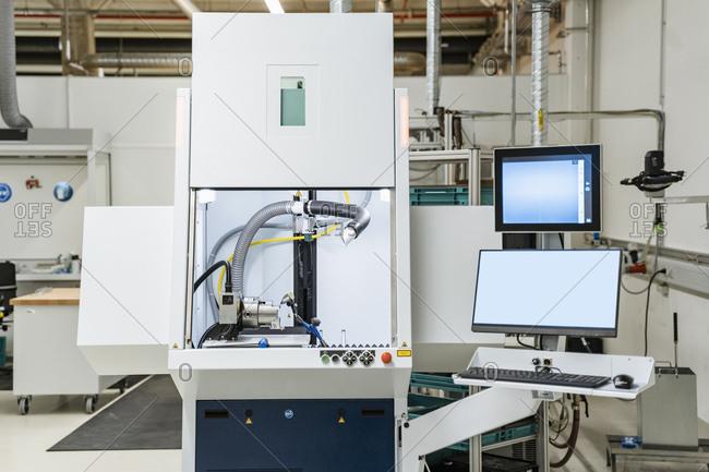 Control station of laser marking system inside modern factory- Stuttgart- Germany