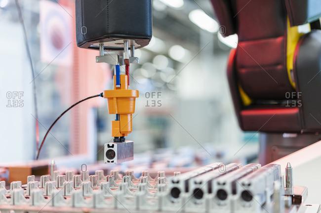 Arm of assembly robotĘpicking up machine part- Stuttgart- Germany
