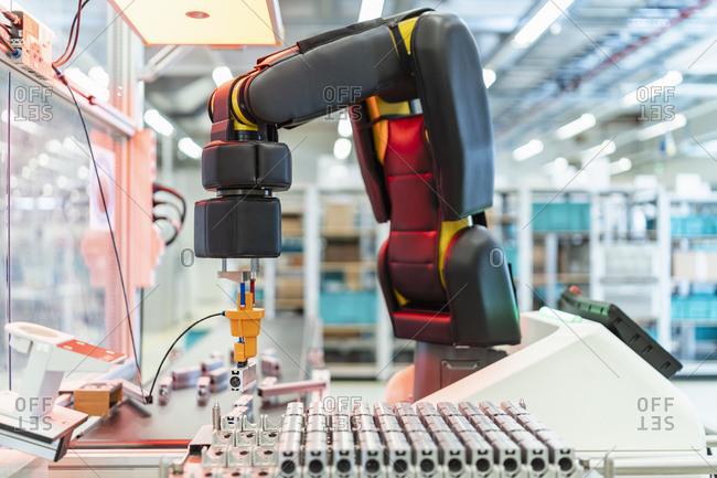 Arm of assembly robotĘpickingĘup machine part- Stuttgart- Germany