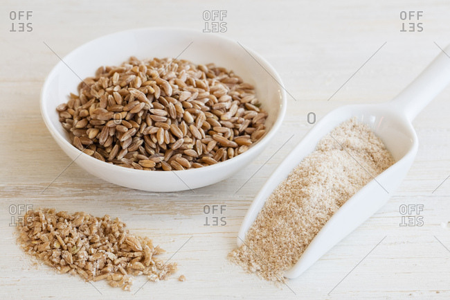 Ancient grains- Emmer in bowl as grain- flakes and flour