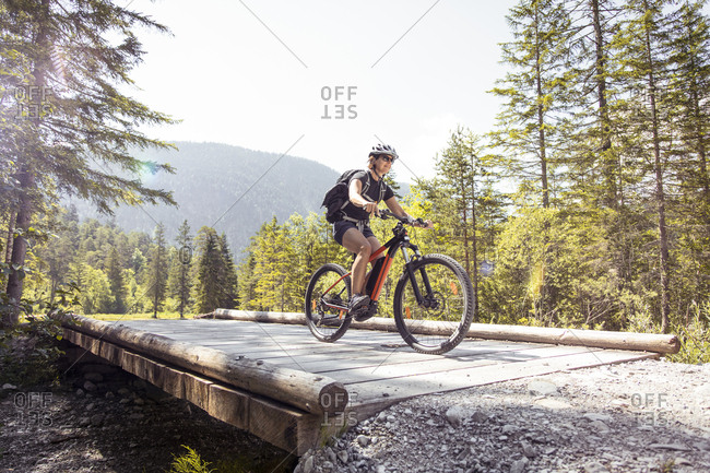 Woman riding  e-mountain bike in the mountains