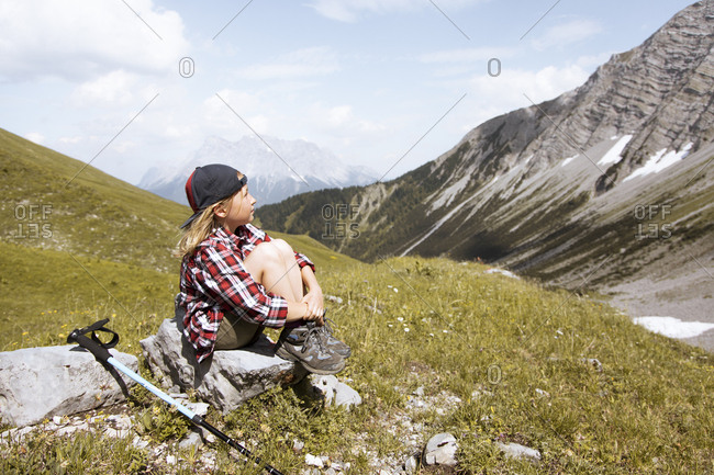 Girl having a break during a hike in the mountains
