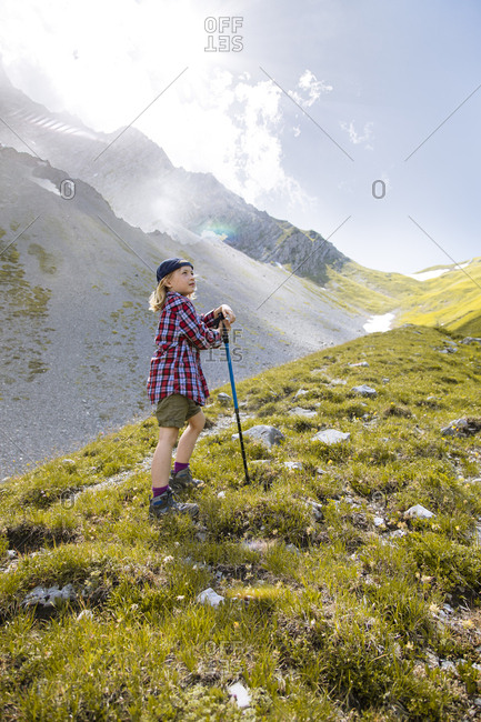Girl hiking in the mountains