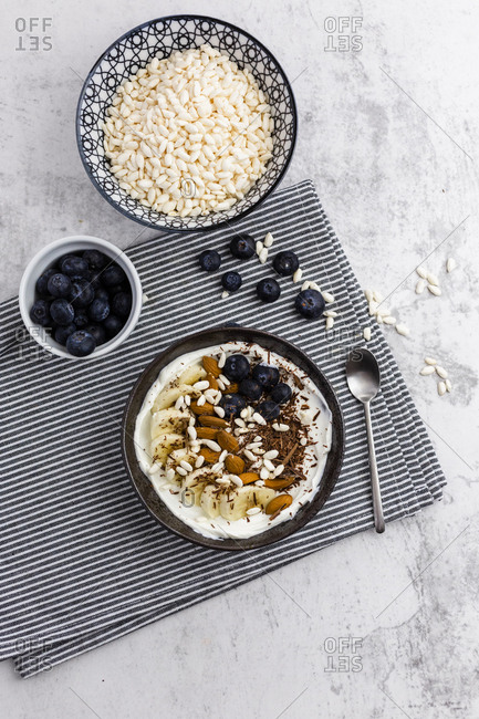 Bowl of fresh muesli- blueberries and puffed rice seen from above