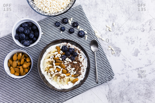 Bowl of fresh muesli- blueberries and almonds seen from above