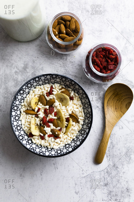 Bowl of fresh muesli and ingredients seen from above