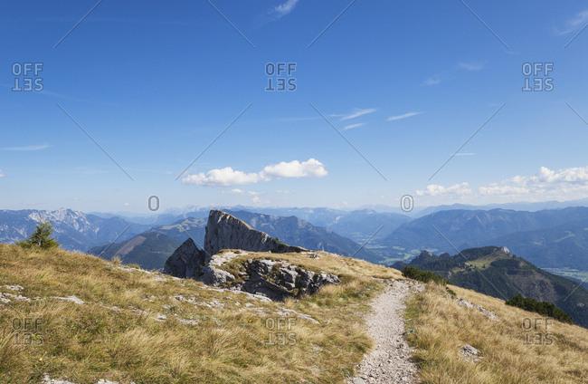 Empty hiking trail on Spinnerin peak against blue sky