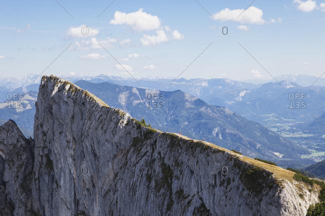 Hiker on Spinnerin peak against blue sky