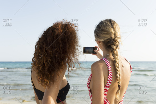 Best friends taking a selfie at the beach