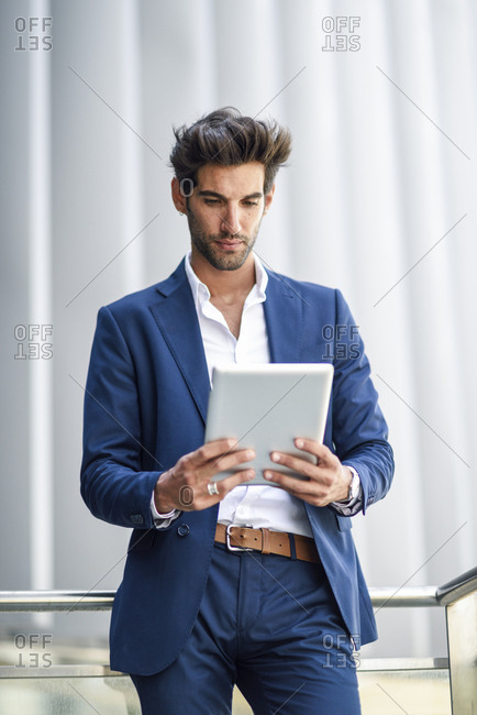 Businessman using tablet outdoors in the city