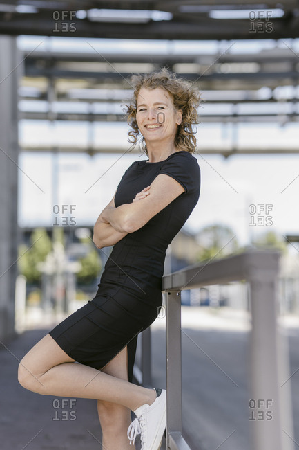 Portrait of smiling mature businesswoman wearing black dress