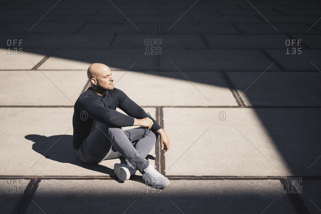 Man having a break sitting at sunlight