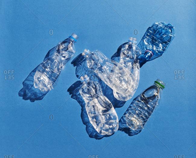 Plastic bottles on blue background