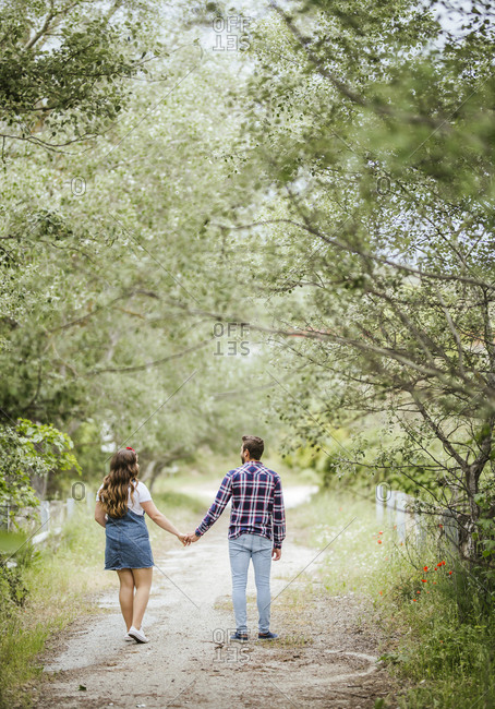 Young couple going for a walk holding hands