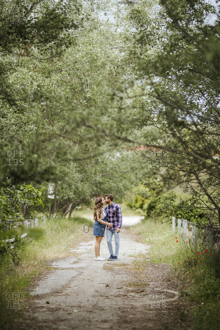 Young couple kissing on a path