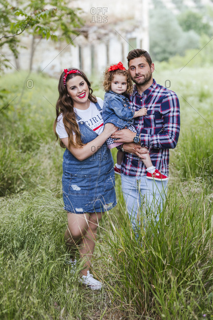 Portrait of a young family in nature
