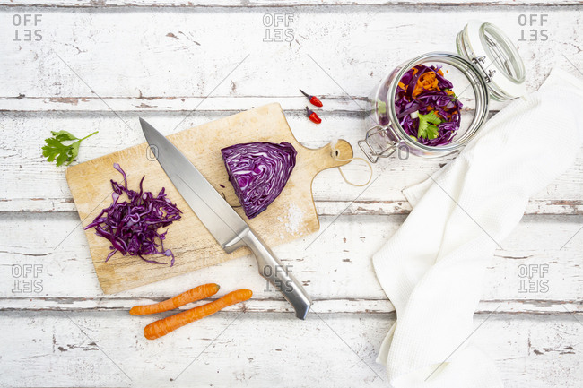 Red cabbage- chili peppers- carrots and coriander on wooden table
