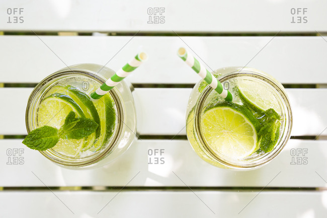 Two glasses of lime-mint lemonade