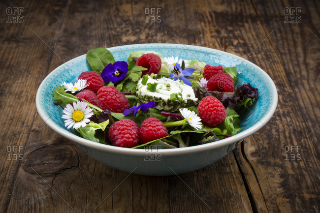 Close-up of fresh salad bowl on wooden table